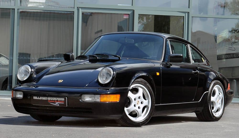 Front view of 1990 Porsche 964 Carrera 4 manual coupe in black for sale