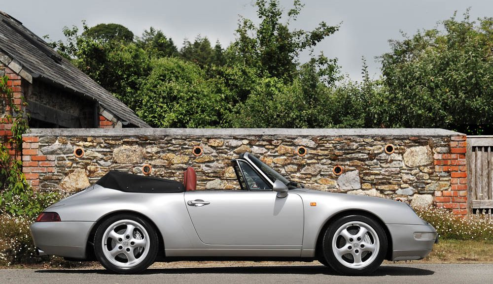 Side view of 1998 Porsche 993 Carrera 4 manual cabriolet for sale