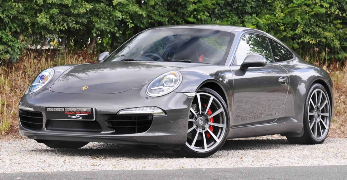 Front view of 2013 model year Porsche 991 Carrera 2 S PDK coupe in Agate grey