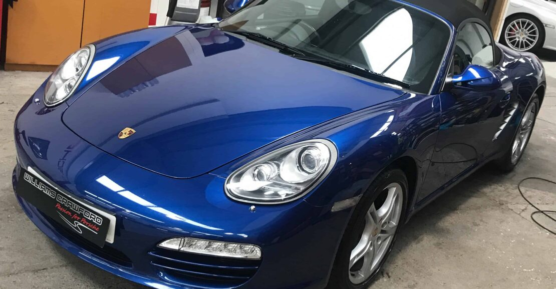 Front view of 2009 Porsche Boxster 987 Gen II manual in aqua blue for sale