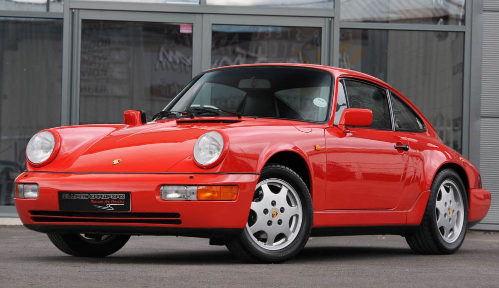 Front view of 1990 Porsche 964 Carrera 4 manual coupe in Guards red for sale